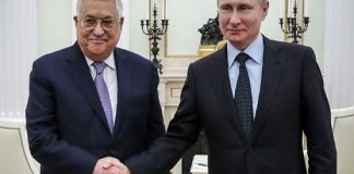 Putin discusses Mideast with Trump, hosts Abbas