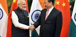 Xi meets Modi, eyes 'new chapter' in China-India ties