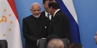President Mamnoon, Modi shake hands at SCO Summit