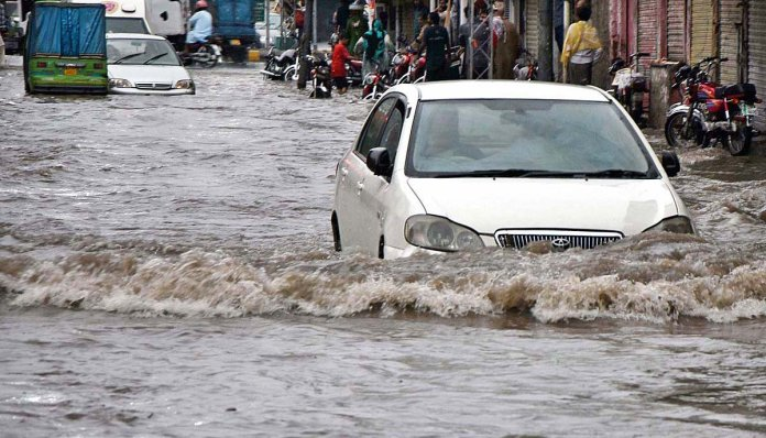Rain water inundates roads, streets after heavy downpour in Peshawar
