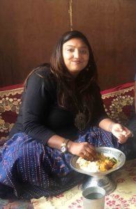 Eating rice & rista at friend's home