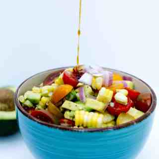 Avocado Corn Salad with White Honey Balsamic Reduction | kickassbaker.com #bbq #potluck #sidedish #cornsalad #avocadosalad #avocado #whitebalsamic #refreshingsummersalad #perfectsummersalad