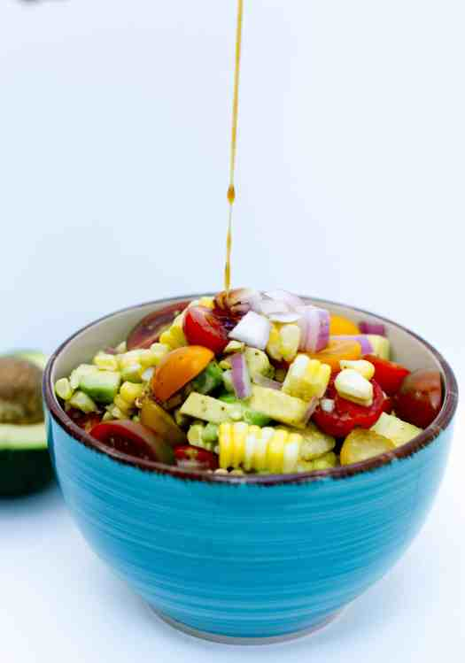 Avocado Corn Salad with White Honey Balsamic Reduction | kickassbaker.com #bbq #potluck #sidedish #cornsalad #avocadosalad #avocado #whitebalsamic #refreshingsummersalad #perfectsummersalad