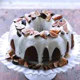 Honey Cake with Goat Cheese Frosting and Figs | kickassbaker.com #figs #goatcheese #honeycake #summer #farmersmarketfinds #farmersmarket #goatcheesefrosting #nutfree #allergeyfriendly #figrecipes #honeyrecipes #baking #easyrecipes #kickassbaker #bloggingmom #nutfreerecipesblog #momblog