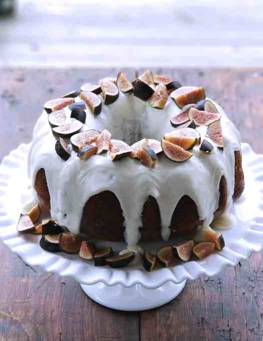 Honey Cake with Goat Cheese Frosting and Figs | kickassbaker.com #figs #goatcheese #honeycake #summer #farmersmarketfinds #farmersmarket #goatcheesefrosting #nutfree #allergeyfriendly #figrecipes #honeyrecipes #baking #easyrecipes #kickassbaker #bloggingmom #nutfreerecipesblog #momblog