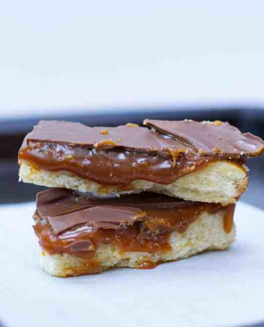 Homemade Twix Bars | kickassbaker.com #twix #homemade #twixbars #caramel #chocolate #dessertrecipes #dessert #easyrecipes #nutfree #peanutfree #allergyfriendly #bakersofinstagram #bakingrecipes #foodblogger #foodbloggerpro #bakefeed #candybarrecipe #foodphotography #foodphotoblog #foodblogfeed #f52gram #kickassbaker #feedfeedbaking #momblogger