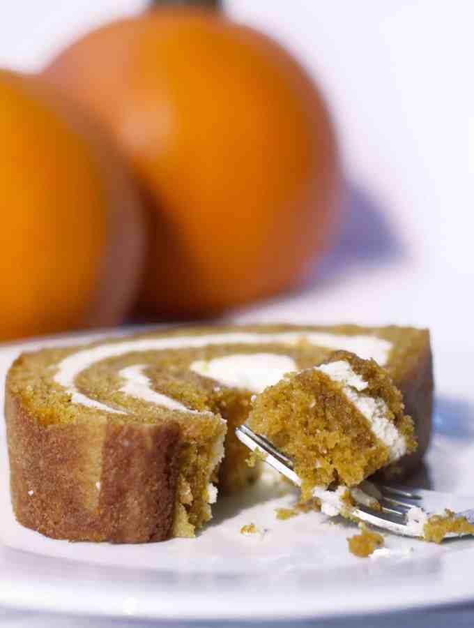 Pumpkin Roll   kickassbaker.com #pumpkinroll #pumpkinrecipes #pumpkin #fallrecipes #fall #autumn #easyrecipes #kickassbaker #creamcheese