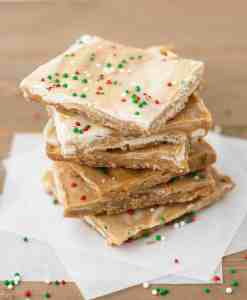 Biscoff White Chocolate Saltine Toffee | kickassbaker.com #biscoff #bark #holidaybaking #holidays #christmascookies #cookieexchange #whitechocolate #bakingrecipes #kickassbaker