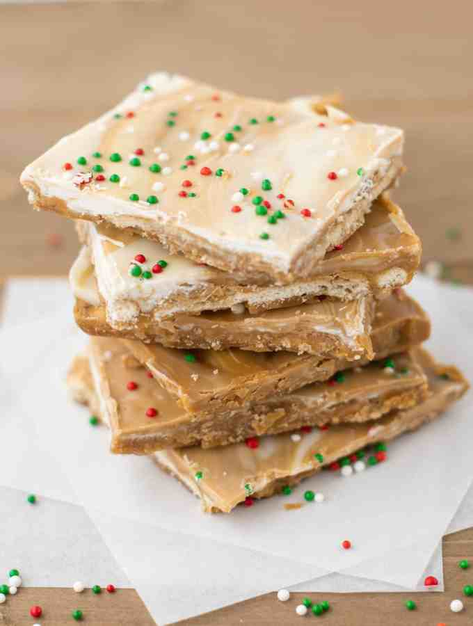 Biscoff White Chocolate Saltine Toffee   kickassbaker.com #biscoff #bark #holidaybaking #holidays #christmascookies #cookieexchange #whitechocolate #bakingrecipes #kickassbaker