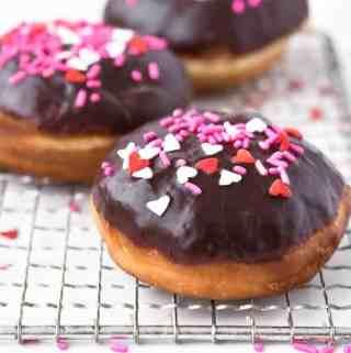Homemade Chocolate Glazed Donuts | kickassbaker.com #donuts #doughtnuts #yeastdoughnuts #chocolateglaze #chocolate #valentinesday #vday #treats #homemade #madefromscratch #kickassbaker