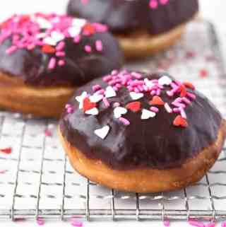 Homemade Chocolate Glazed Donuts | kickassbaker.com #donuts #doughtnuts #yeastdoughnuts #chocolateglaze #chocolate #valentinesday #vday #treats #homemade #madefromscratch #kickassbaker
