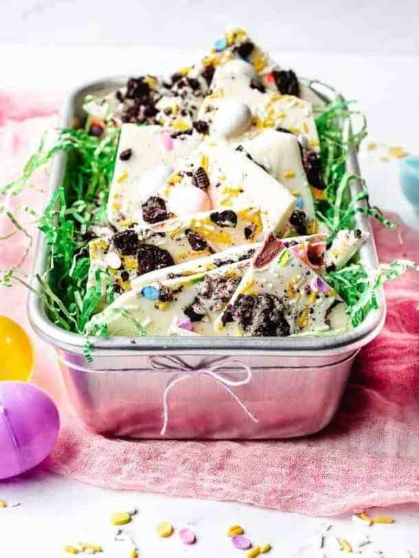 White Chocolate Oreo Easter Bark | kickassbaker.com #easter #dessert #easyrecipe #easyrecipes #nobake #oreo #whitechocolate #cadburyeggs #cadbury #bark #kickassbaker #holiday #treats #kidfriendly #nonuts #peanutfree #nutfree