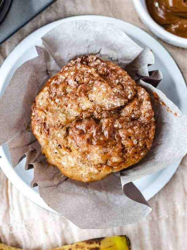 Overhead shot of single banana dulce de leche muffin with wrapper opened