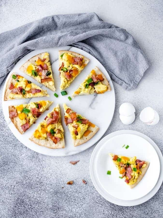 overhead image of cauliflower breakfast pizza sliced