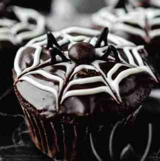 Close up image of halloween spider cupcakes