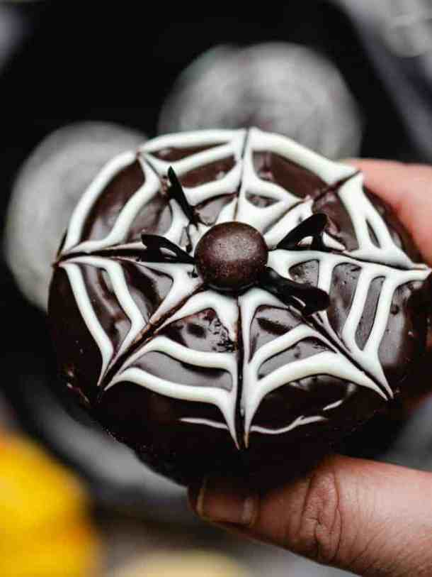 Close up photo of halloween cupcake with spider web design