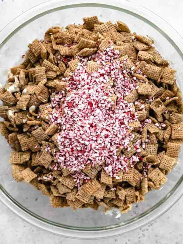 Overhead of Chex cereal in a bowl with peppermint candies