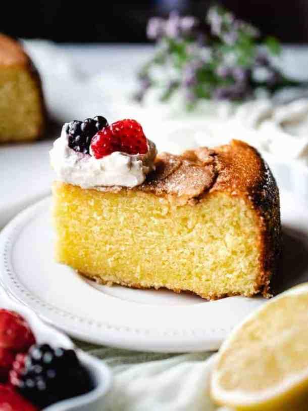 Hero shot of slice of lemon olive oil cake on a plate