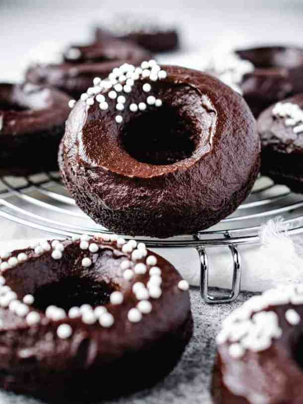plant-based fudgy chocolate donuts with chocolate frosting and white sprinkles