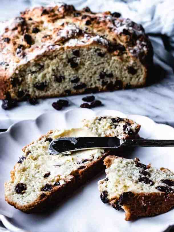 Irish soda bread with slices spread with Kerry gold butter