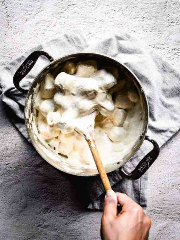 melting marshmallows with brown butter to make s'mores Rice Krispies