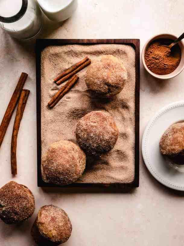 cinnamon sugar donut muffins sitting in cinnamon sugar