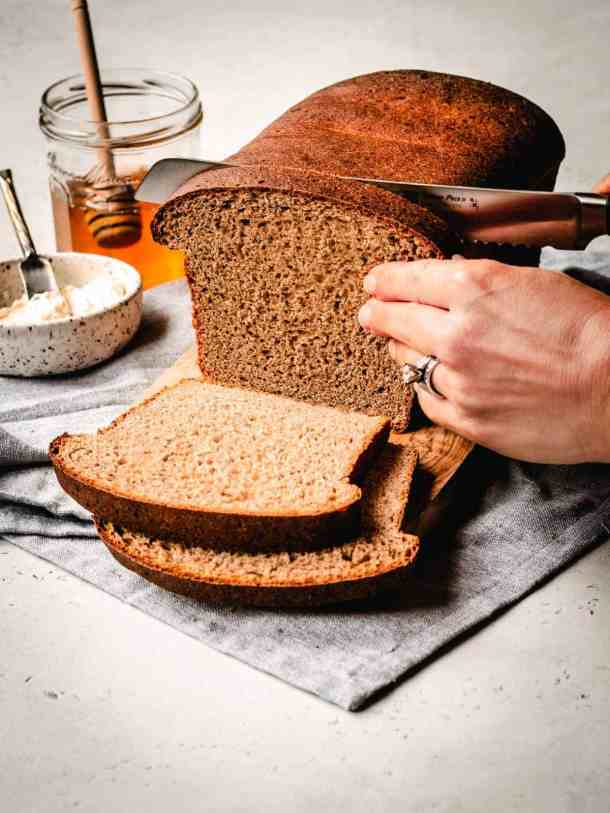 slicing honey whole wheat sandwich bread