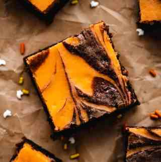 close up of orange and black cream cheese swirled brownie for Halloween