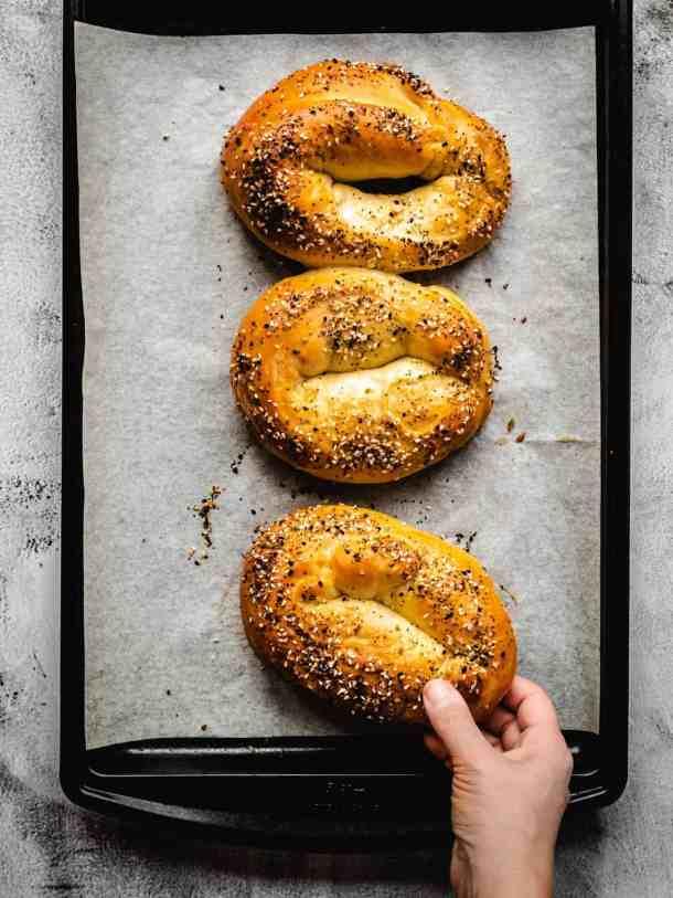 grabbing for a homemade Jerusalem bagel