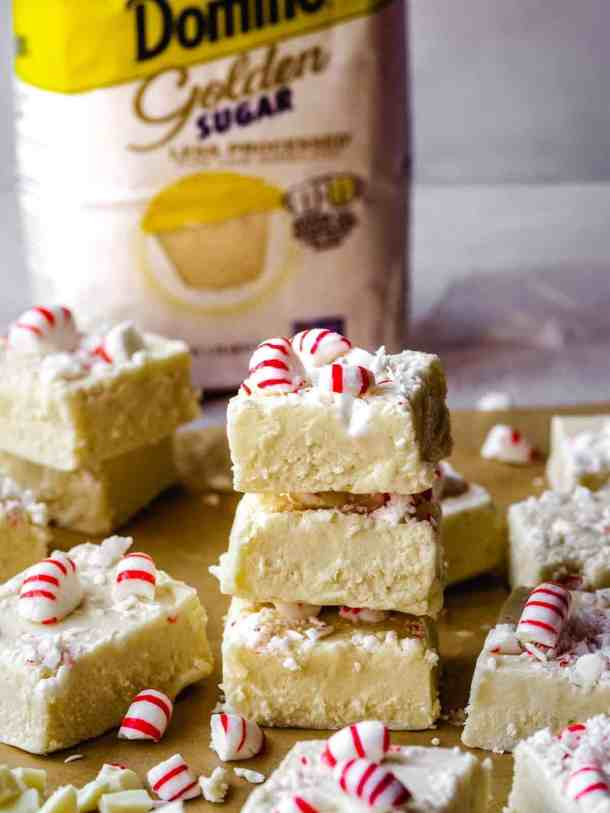 stack of 3 pieces of white chocolate candy cane fudge