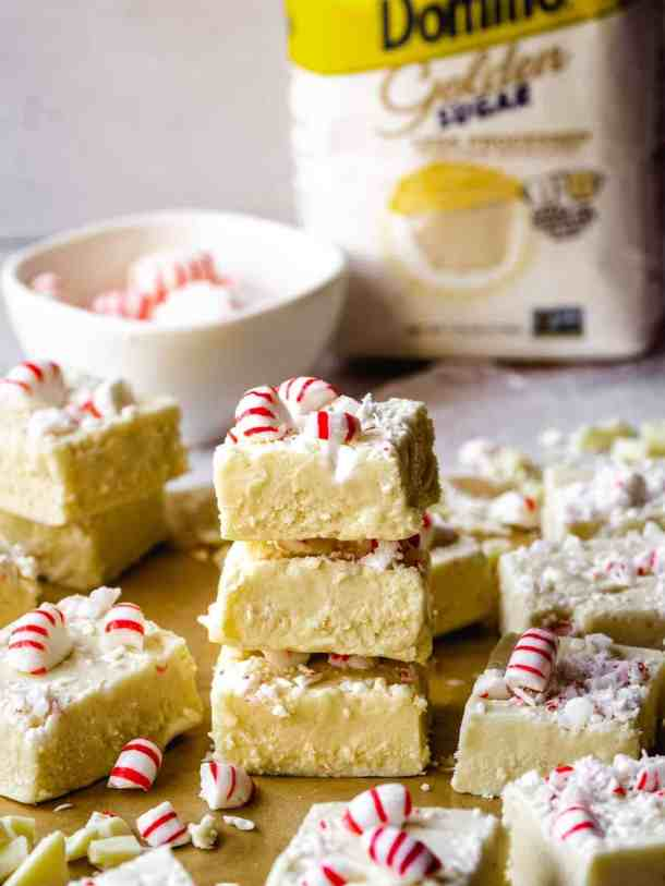 stack of white chocolate peppermint fudge with domino sugar closer up