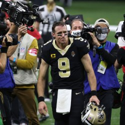 NEW ORLEANS, LOUISIANA - JANUARY 17: Drew Brees #9 of the New Orleans Saints walks off the field after being defeated by the Tampa Bay Buccaneers in the NFC Divisional Playoff game at Mercedes Benz Superdome on January 17, 2021 in New Orleans, Louisiana. (Photo by Chris Graythen/Getty Images)