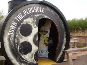 Entrance to a sewer exhibition that looks like a plughole