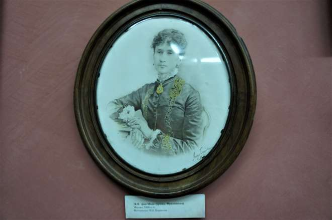 An oval black and white portrait of a woman in Victorian era clothes