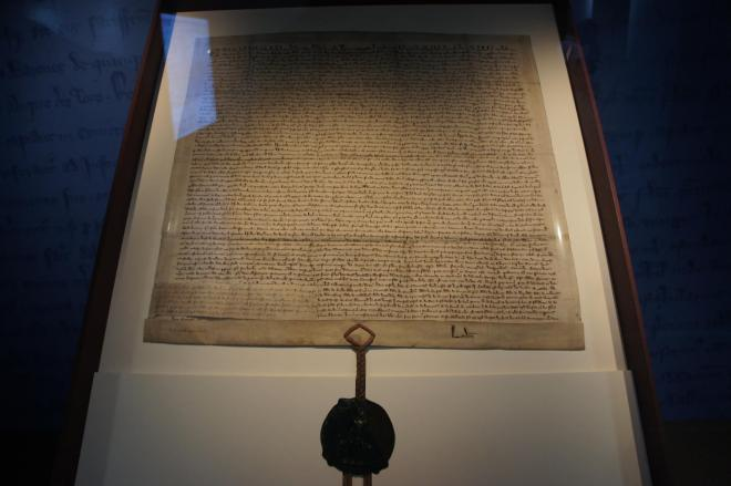 A picture of the Magna Carta, an old parchment with a large seal at the bottom