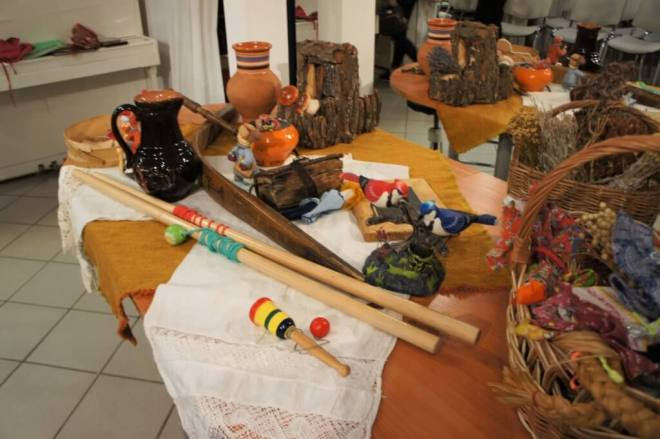A table covered with items associated with Russian folk crafts and games