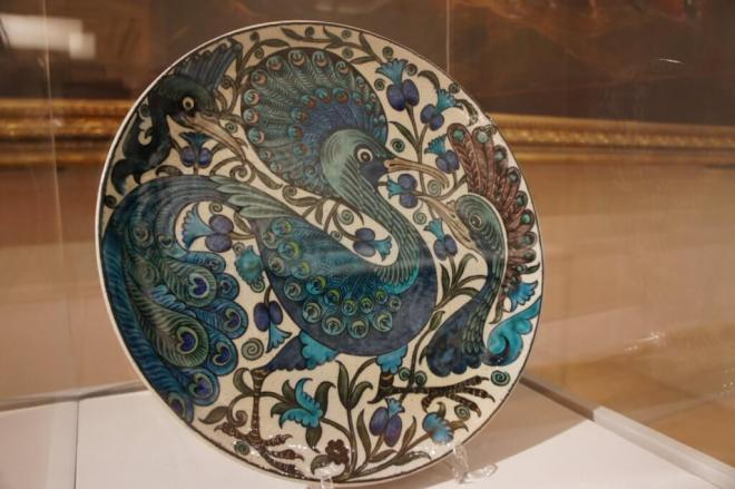 A large plate with a styalised blue bird design by William de Morgan