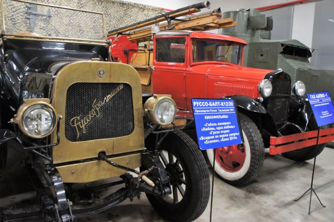 An old car and an old fashioned red fire engine at the MosFilm Studio