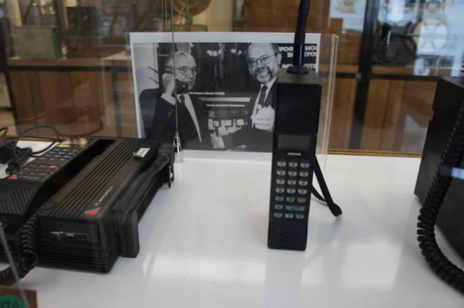 An early mobile phone with a photo of Gorbachov behind it at the Museum of Telephone History Moscow