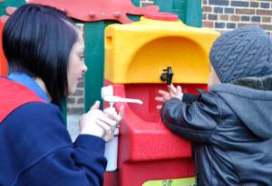 Teaching hand washing with a KiddiSynk portable unit
