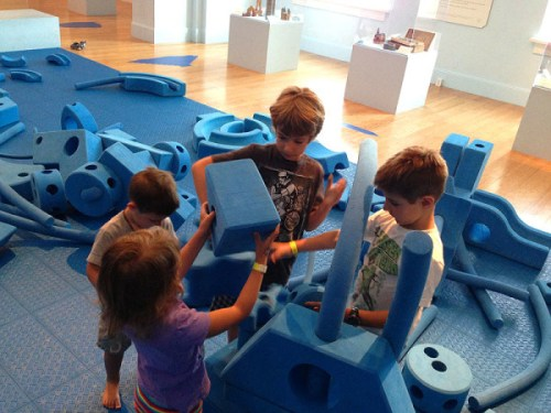 A team building effort at the National Building Museum's PLAY WORK BUILD exhibit