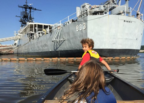 Checking out the USS Barry on a paddling excursion