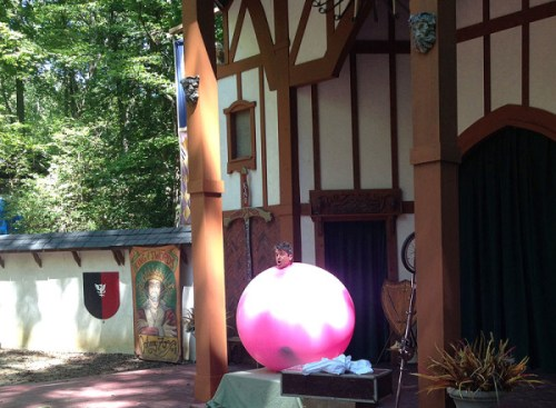 A man stuffed in a giant pink balloon - of course!