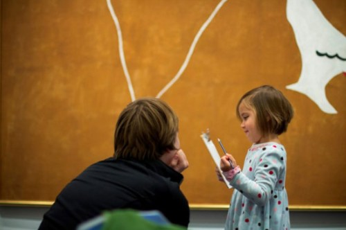 A mother and child stop at a painting before drawing at the Hirshhorn Museum and Sculpture Garden