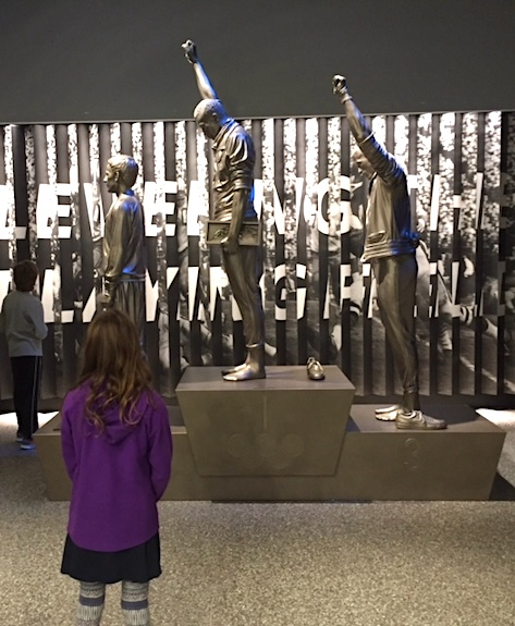 A Statue of the famous 1968 Olympics Black Power salute at the African American History & Culture Museum