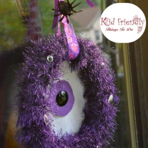 A DIY One-eyed Monster Wreath craft for Halloween - easy to make and so cute as a Halloween decoration - www.kidfriendlythingstodo.com