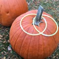 Use Glow in the Dark Necklaces as rings for an easy & fun Pumpkin Ring Toss Game! - KidFriendlyThingsToDo.com