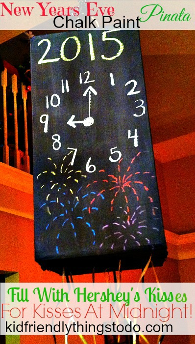 Such a fun thing to do with or without the kids! A box painted with chalk so you can change the time as the night progresses! Fill it with Hershey's Kisses - so kids can have their Kisses at Midnight! - Kid Friendly Things To Do .com