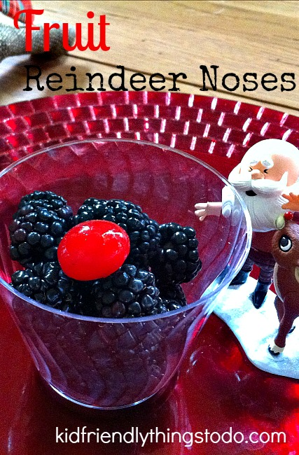 A non-candy Holiday Fruit Cup of Reindeer Noses with one sweet treat for a Rudolph Nose! Fun idea for Christmas parties with kids!