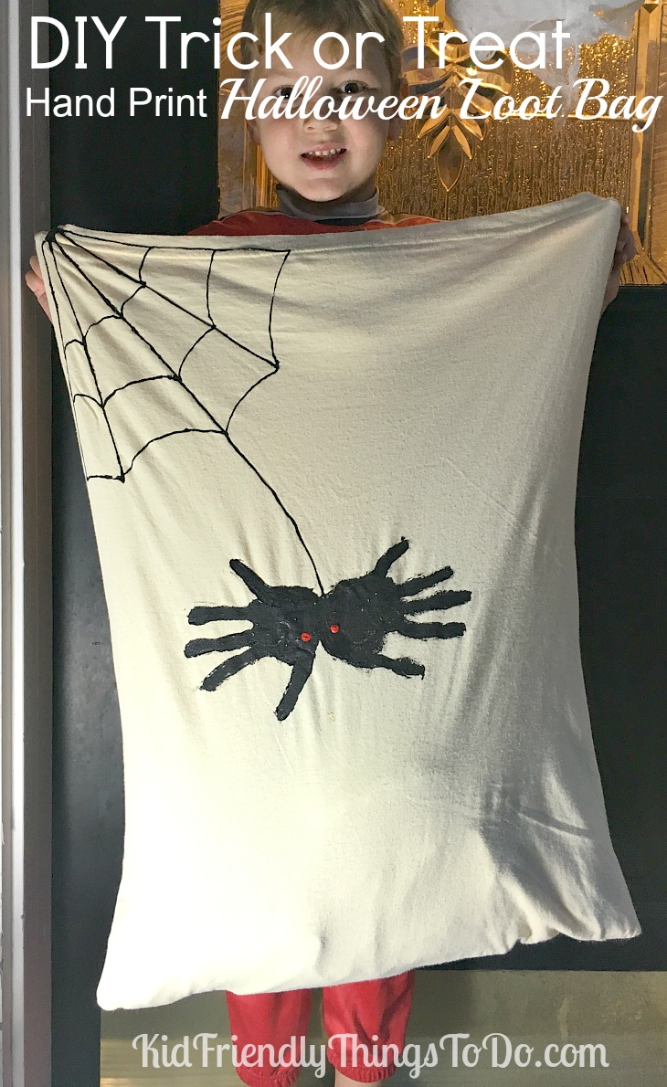 DIY handprint Halloween Spider Candy Bag using a pillowcase! Make your own spider loot bag